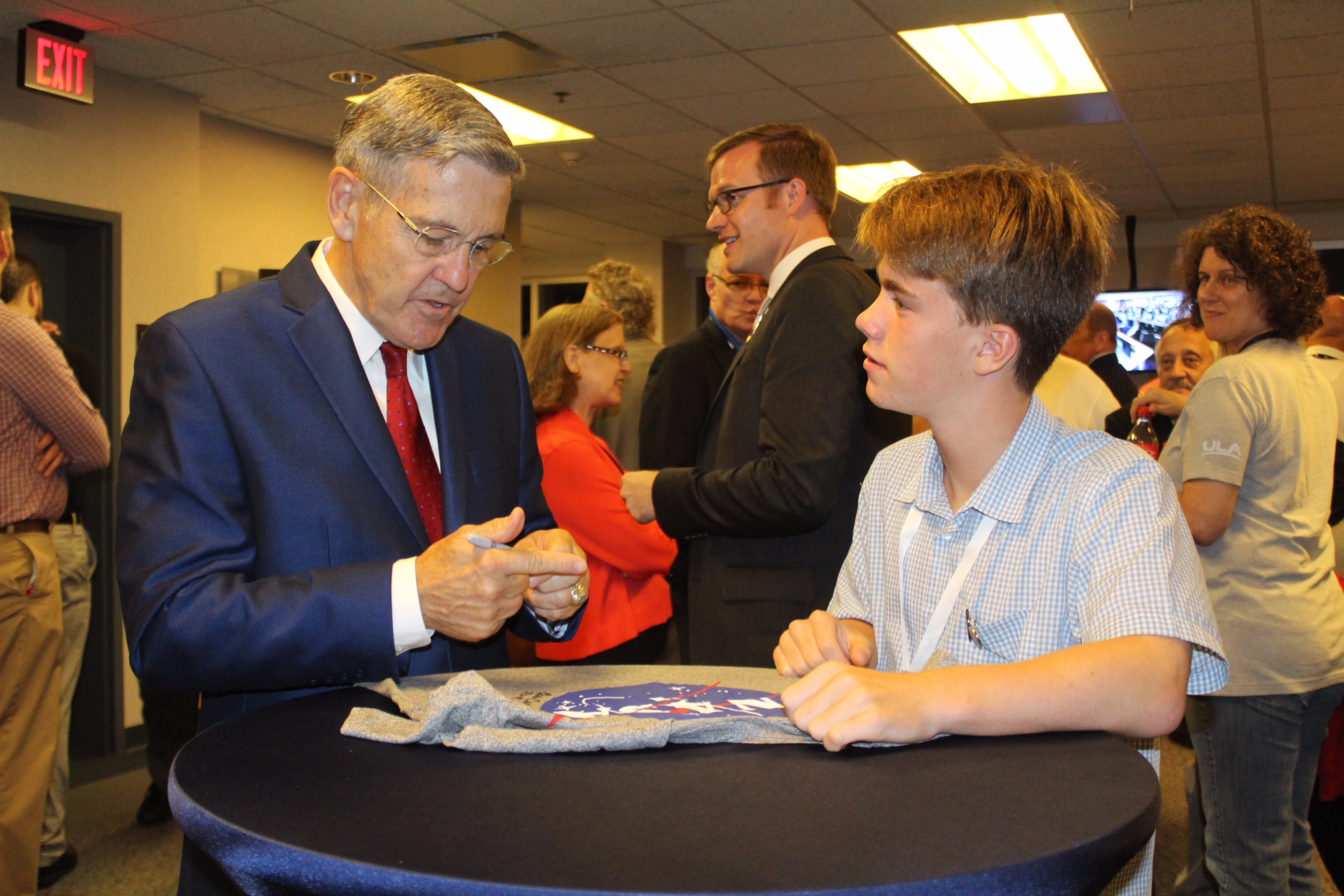 Ollie meeting the Director of Kennedy Space Centre and four time Astronaut, Bob Cabana.